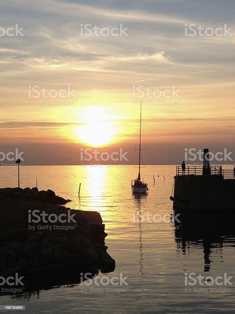 Sailing yacht and sunset stock photo