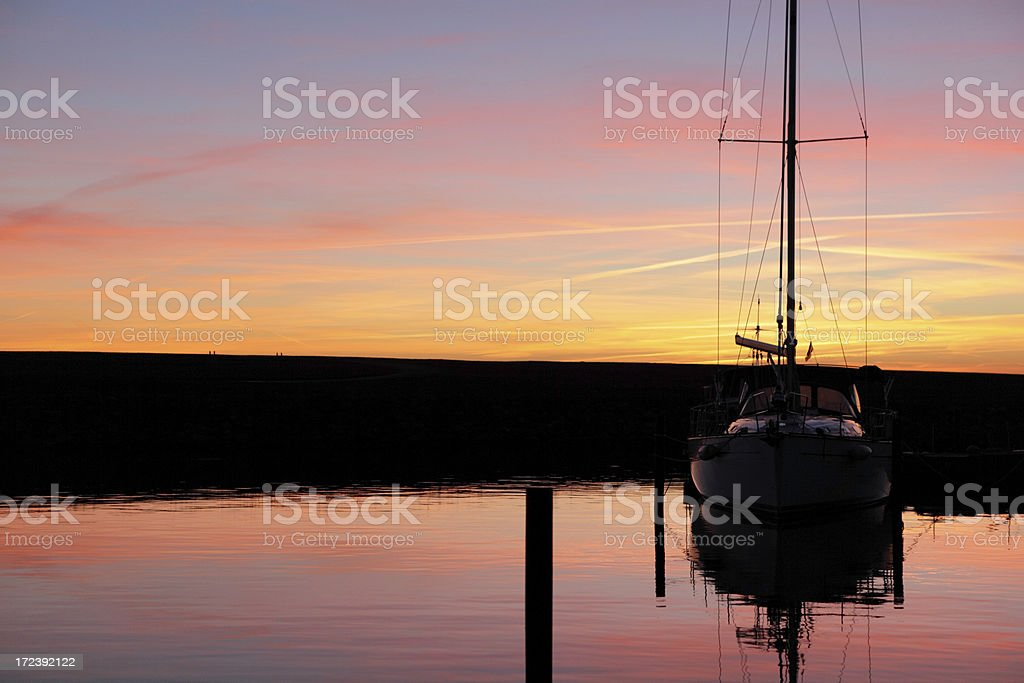 Sailing yacht at sunset stock photo
