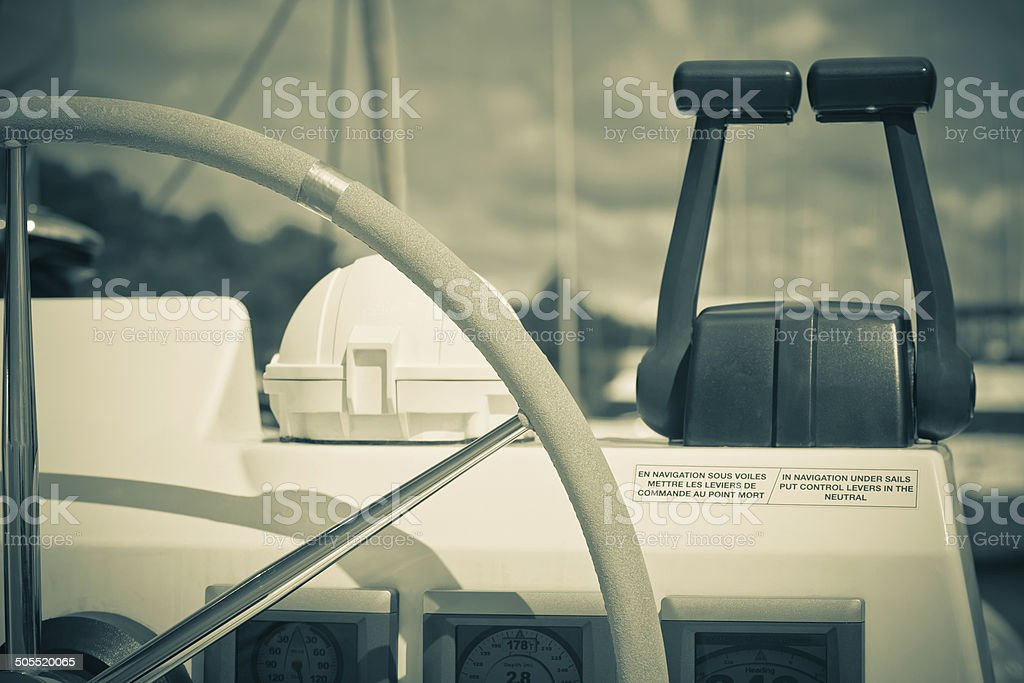 Sailing yacht control wheel and implement royalty-free stock photo