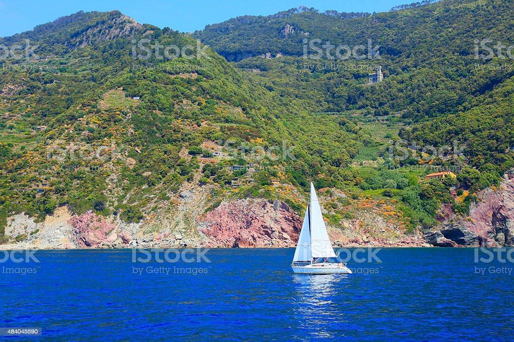 Sailing yacht in italian riviera, near Lerici – Cinque Terre, Liguria. stock photo