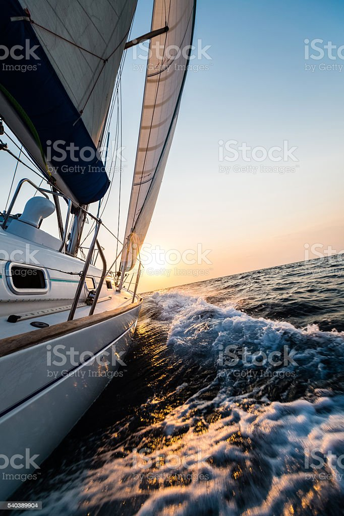 Sailing yacht in the sea stock photo