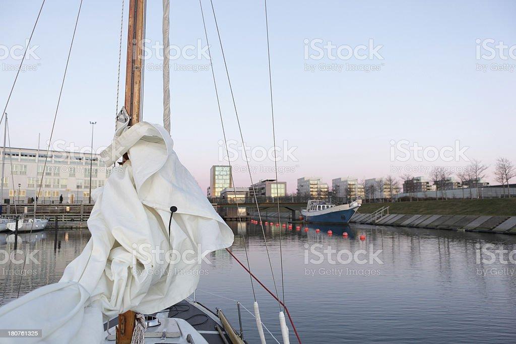 Sailing yacht returns to marina stock photo