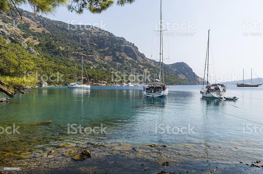 Sailing yachts anchorage at beautiful calm bay stock photo