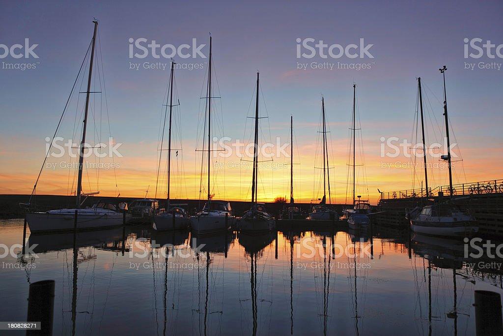 Sailing yachts at sunset stock photo