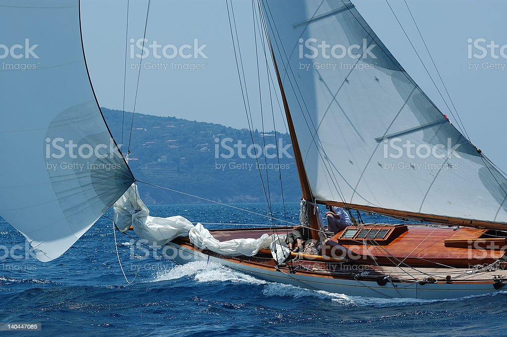 Sailing yachts in the wind with white spinnaker royalty-free stock photo