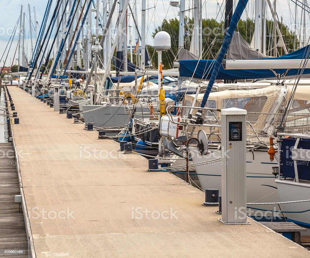 Sailing Yachts Parked in a Harbor stock photo