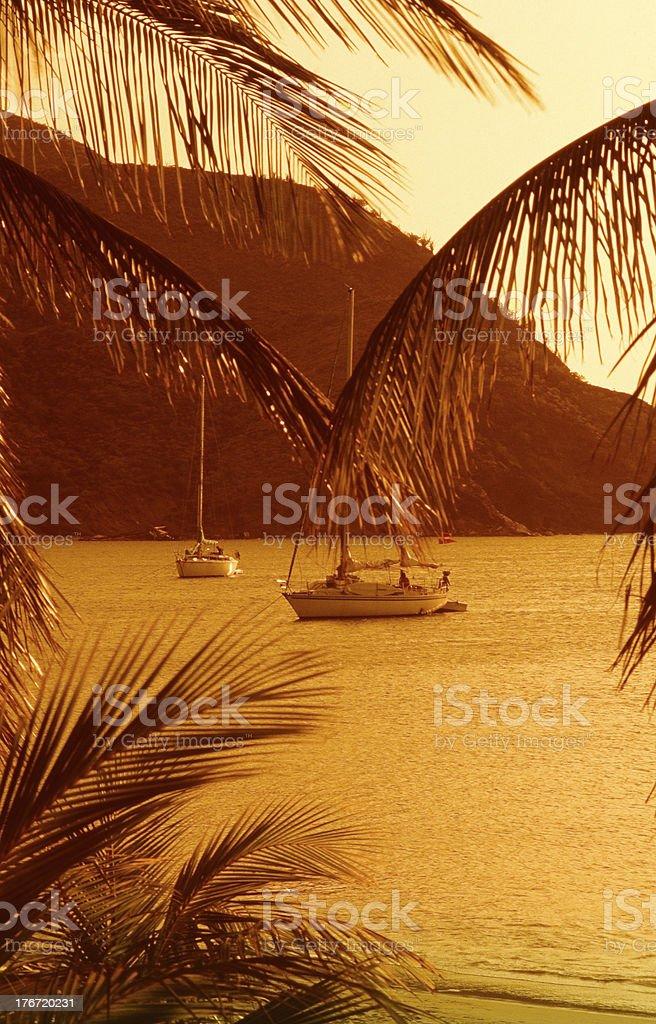 Sailingboat anchored in tropical bay stock photo