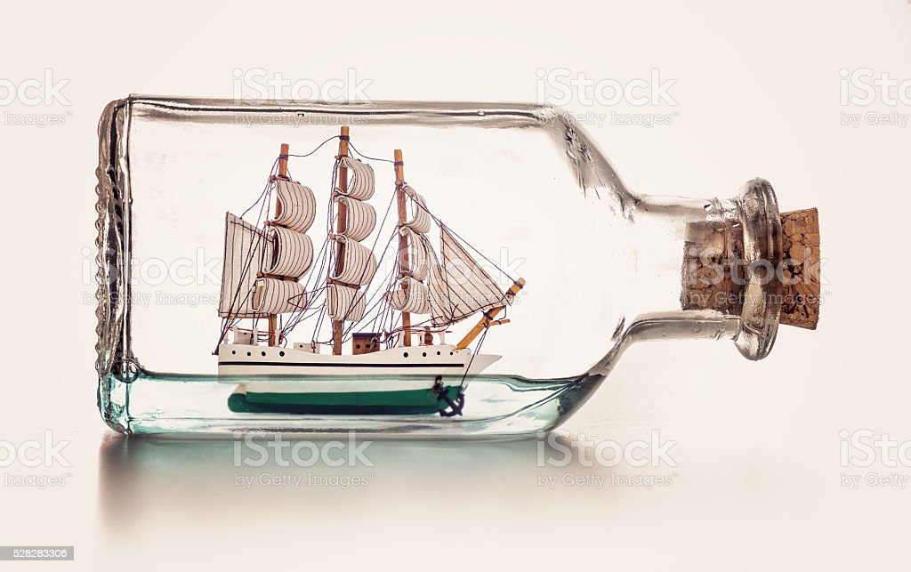 sailingboat in a bottle stock photo