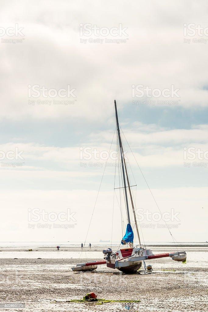 Sailingboat on beach stock photo