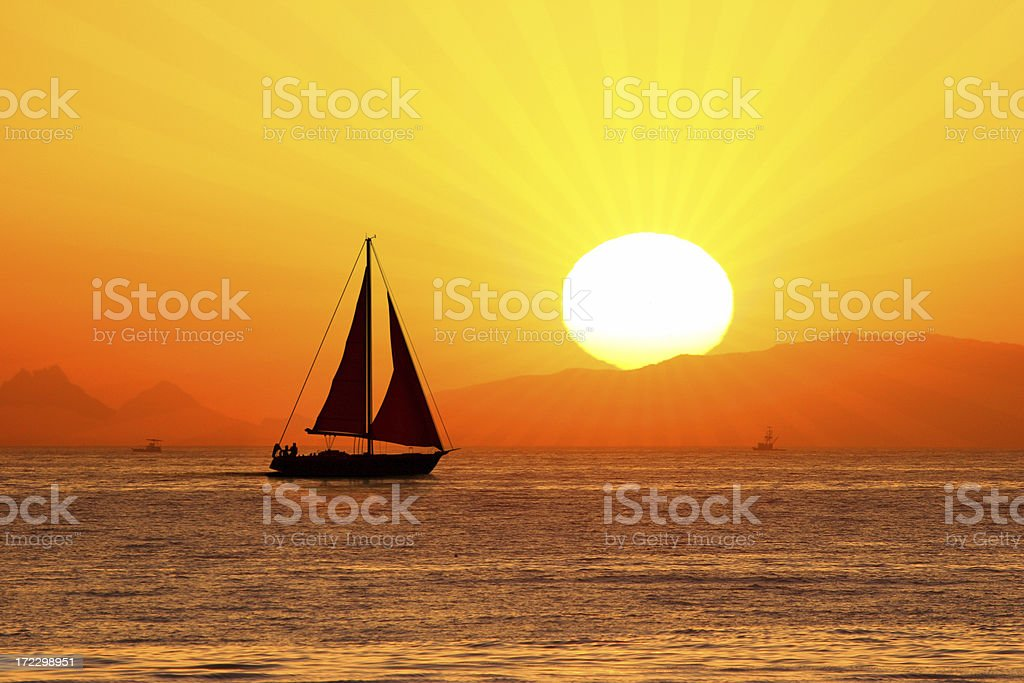 Sailing-more prominent sunrays royalty-free stock photo