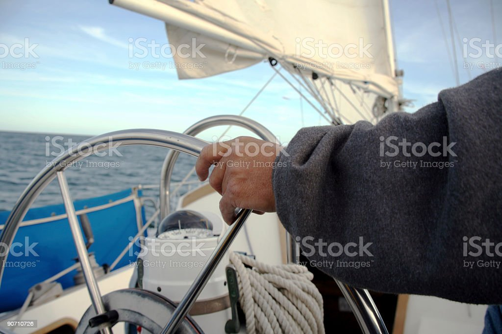 Sailor driving his sailboat stock photo