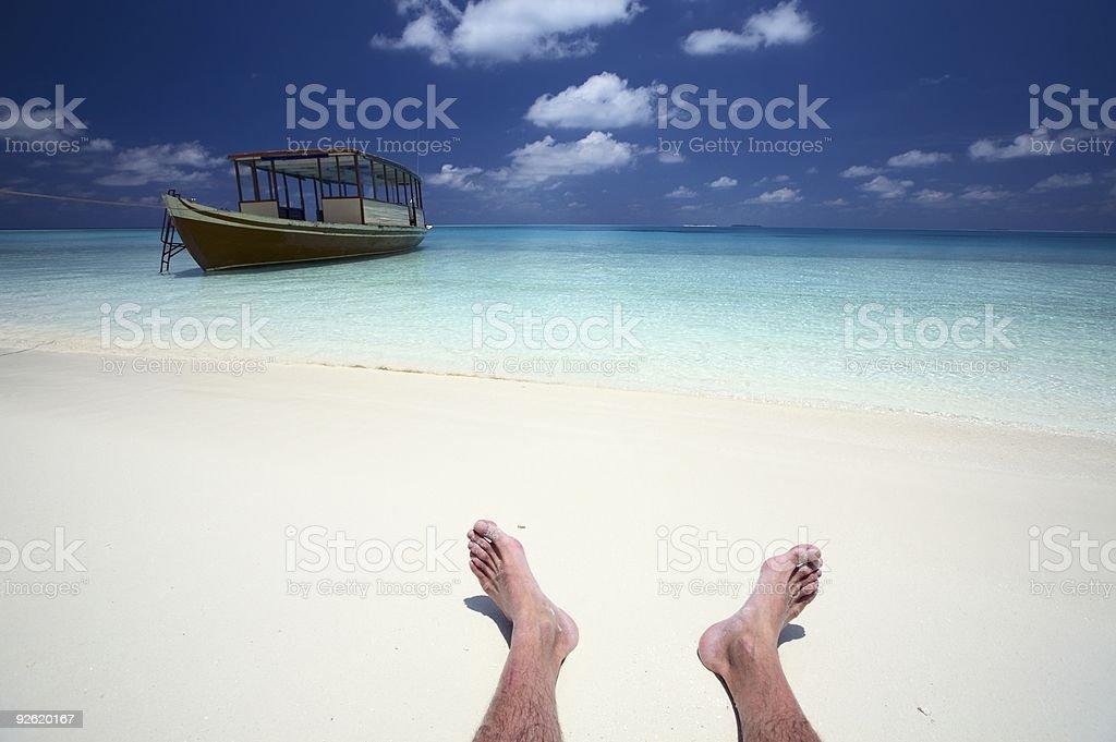 sailor has rest on a beach stock photo