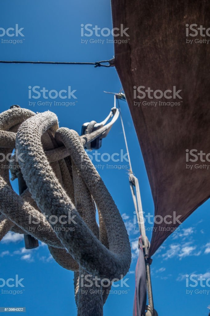 Sailor knot in a wooden boat stock photo