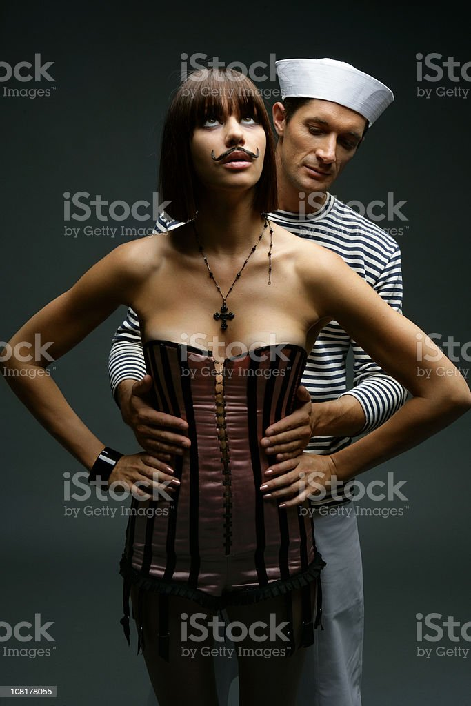 Sailor Man Hugging Woman with Crazy Mustache royalty-free stock photo