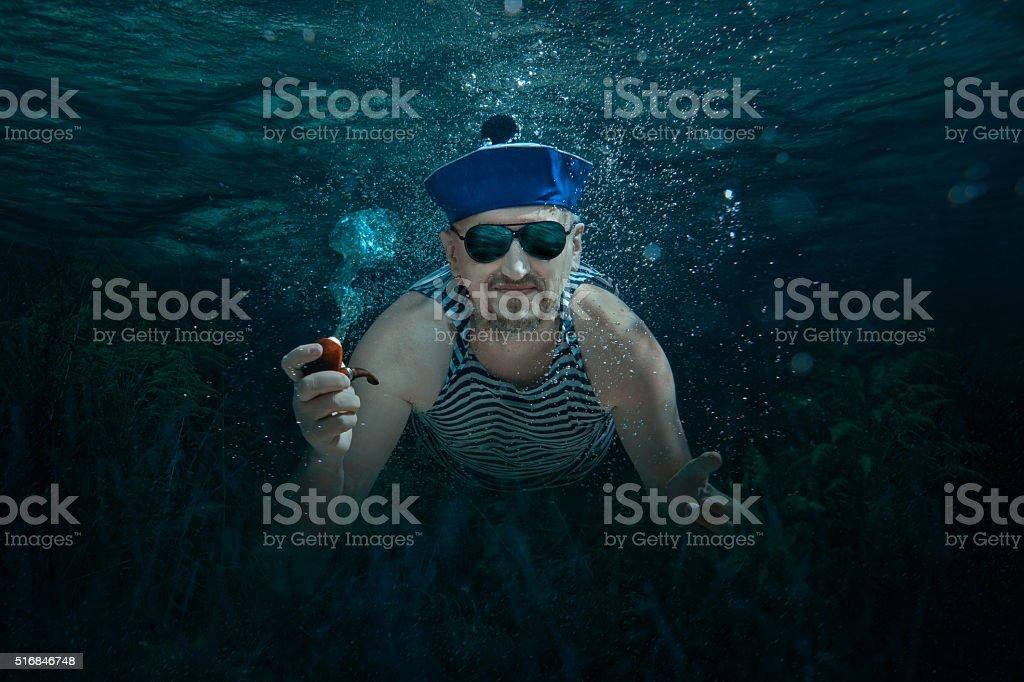 Sailor man under water. stock photo