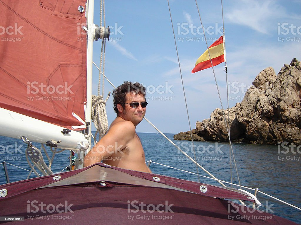 Sailor on his sailboat in the Mediterranean royalty-free stock photo