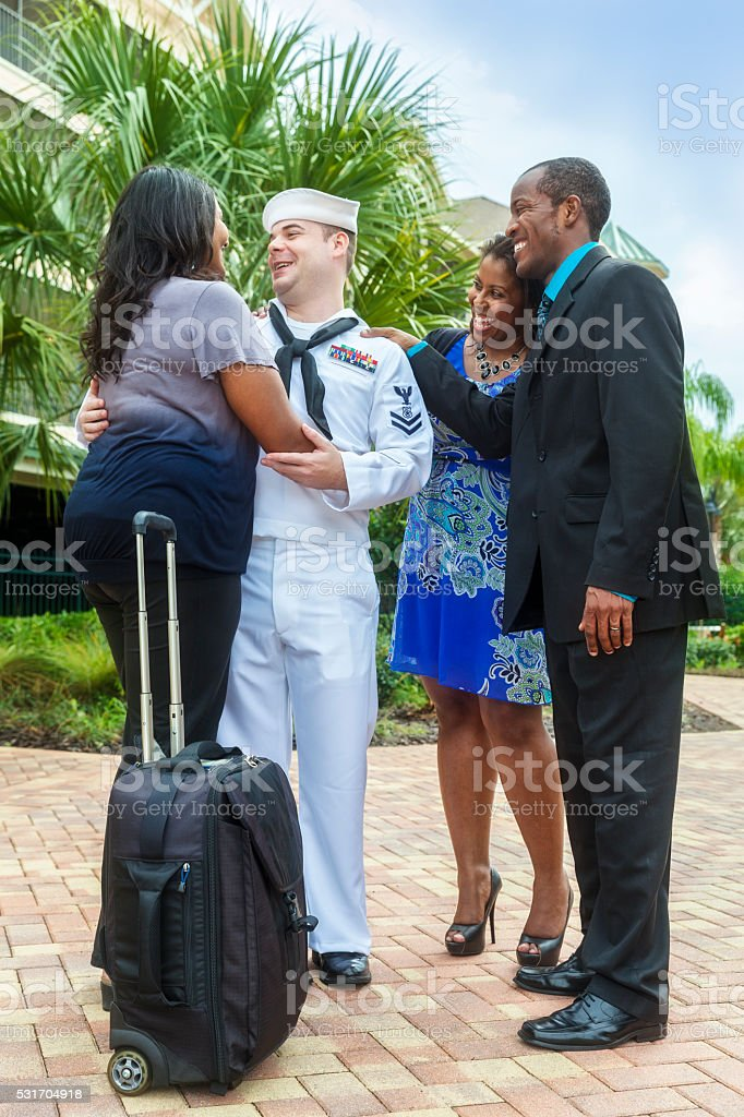 Sailor Returns Home from Active Duty Greeted by Family stock photo