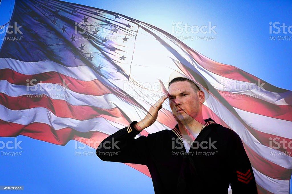 Sailor Saluting to American Flag stock photo