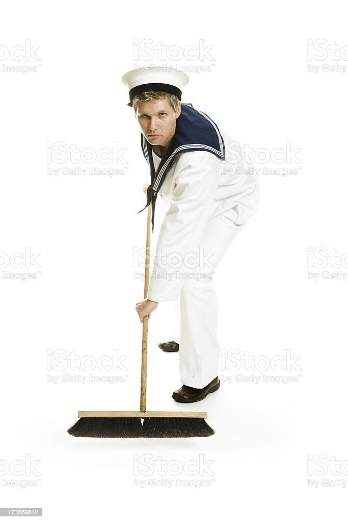 Sailor sweeping floor royalty-free stock photo