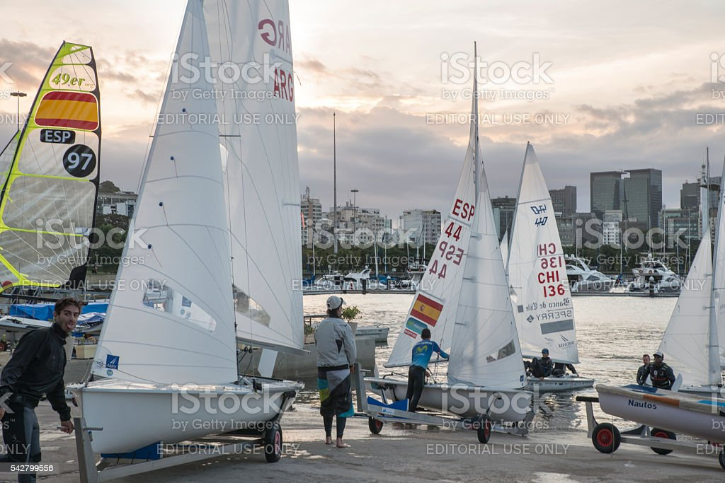 Sailors and 470 dinghy sailboats out of the water stock photo