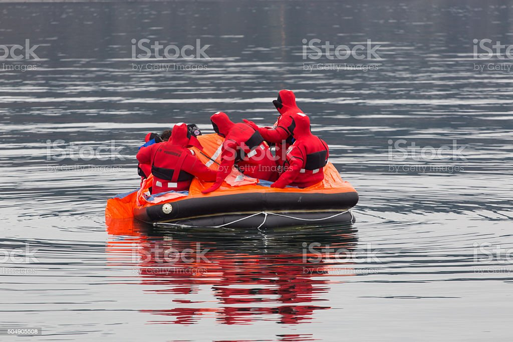 Sailors in a life boat stock photo