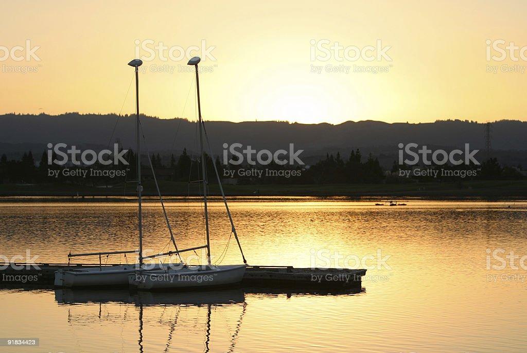 Sails at sunset royalty-free stock photo