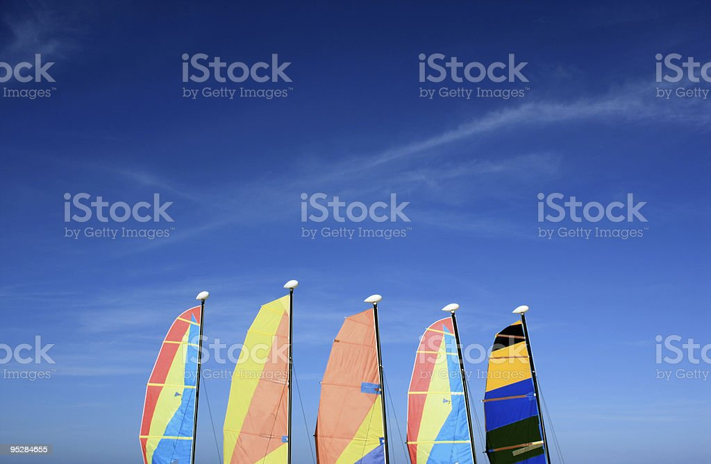 Sails in a beautiful blue sky stock photo