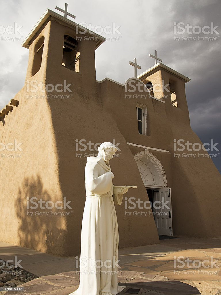 Saint Francis Statue With Church royalty-free stock photo