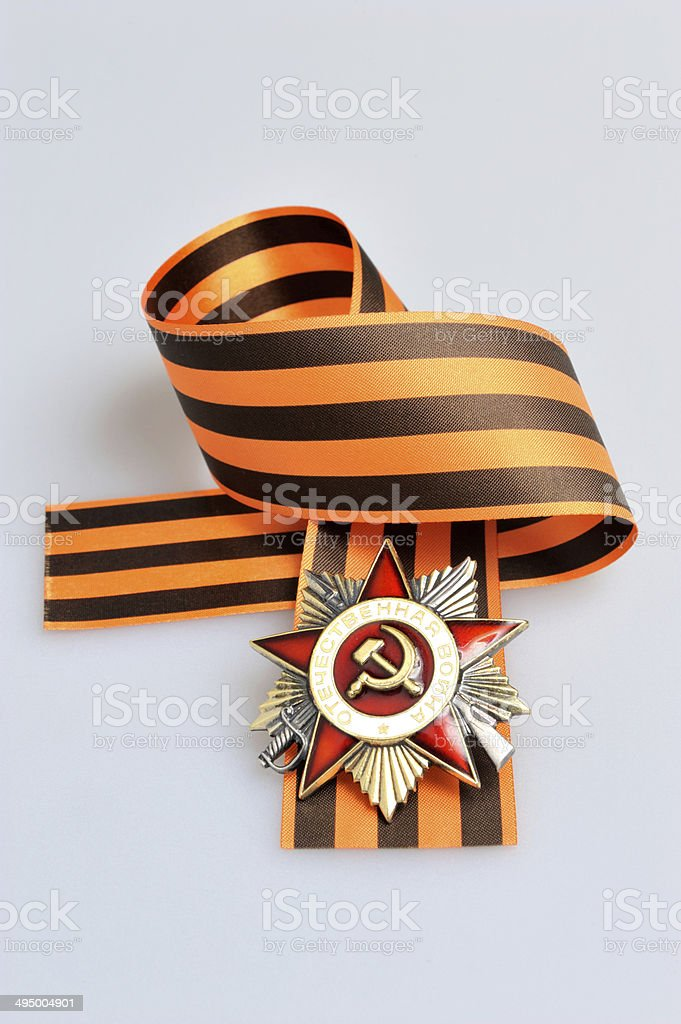 Saint George ribbon, order of Great Patriotic war on gray stock photo