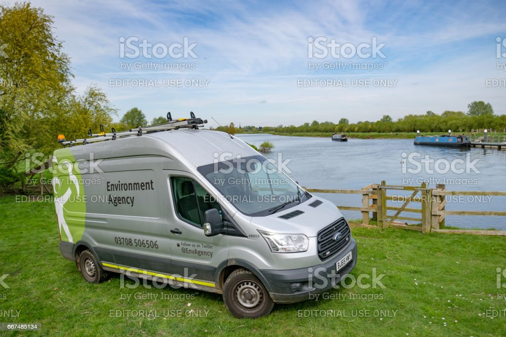 Saint Ives, Cambridgeshire, UK - April 11 2017: Large, commercial vehicle used by a UK environment protection agency, seen parked by a large water inlet and lock system. stock photo