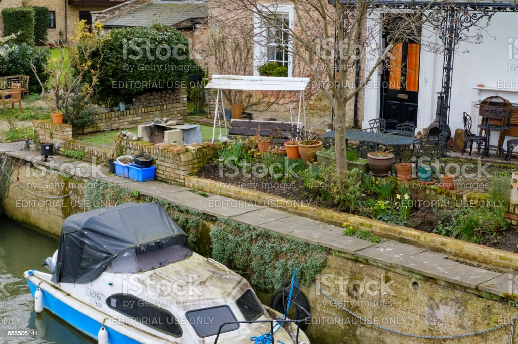 Saint Ives, Cambridgeshire UK - March 13 2017: Moored cabin cruisers seen on an inland waterway and river system within the UK.  Image taken from a nearby spanning bridge. stock photo