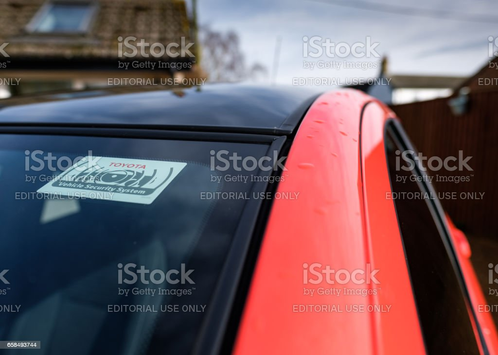 Saint Ives, Cambridgeshire UK - March 4 2017: New, hybrid powered small car manufactured by a well-known Japanese motor company. The car is seen parked at a private residence, just after a rain shower. stock photo