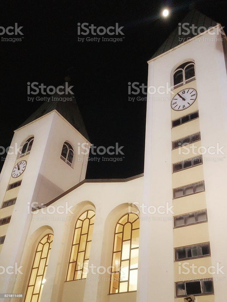 Saint James Church, Medjugorje, Bosnia, Full Moon Night Sky stock photo