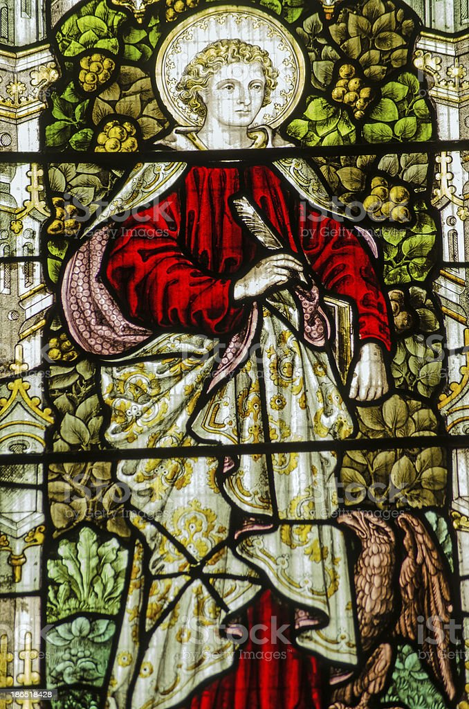 Saint John stained glass window stock photo