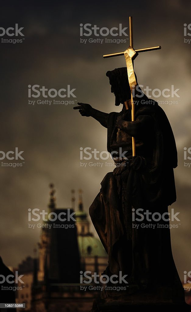 Saint John the Baptist with golden cross stock photo