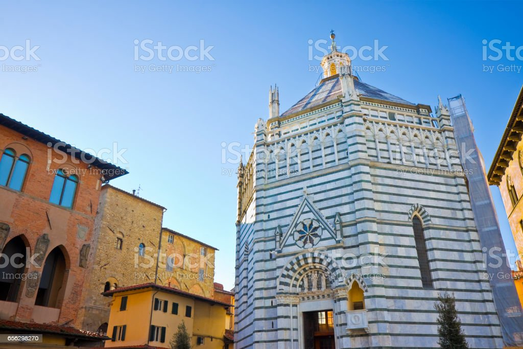 Saint John's baptistery in Pistoia city built in the year 1303 with an octagonal base - On the left the Episcopal Palace (Tuscany - Italy) stock photo