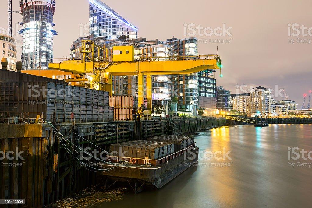 Saint Katherine docks at night with River Thames stock photo