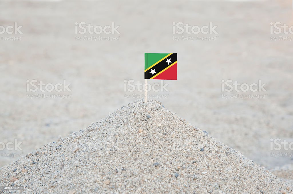 Saint Kitts and Nevis Flag on the Beach stock photo