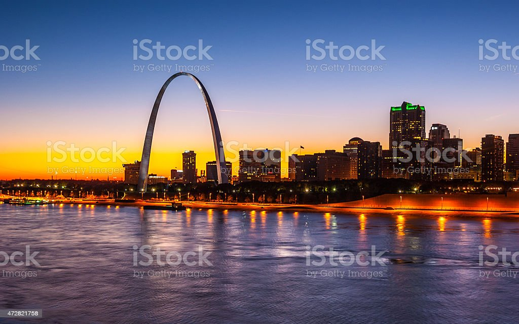 Saint Louis at sunset with blue/yellow sky and backlit skyline stock photo