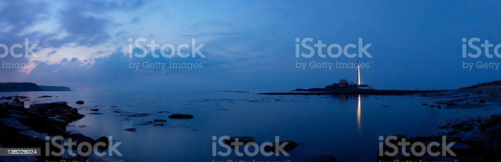 Saint Mary's Lighthouse, Whitley Bay in the distance stock photo