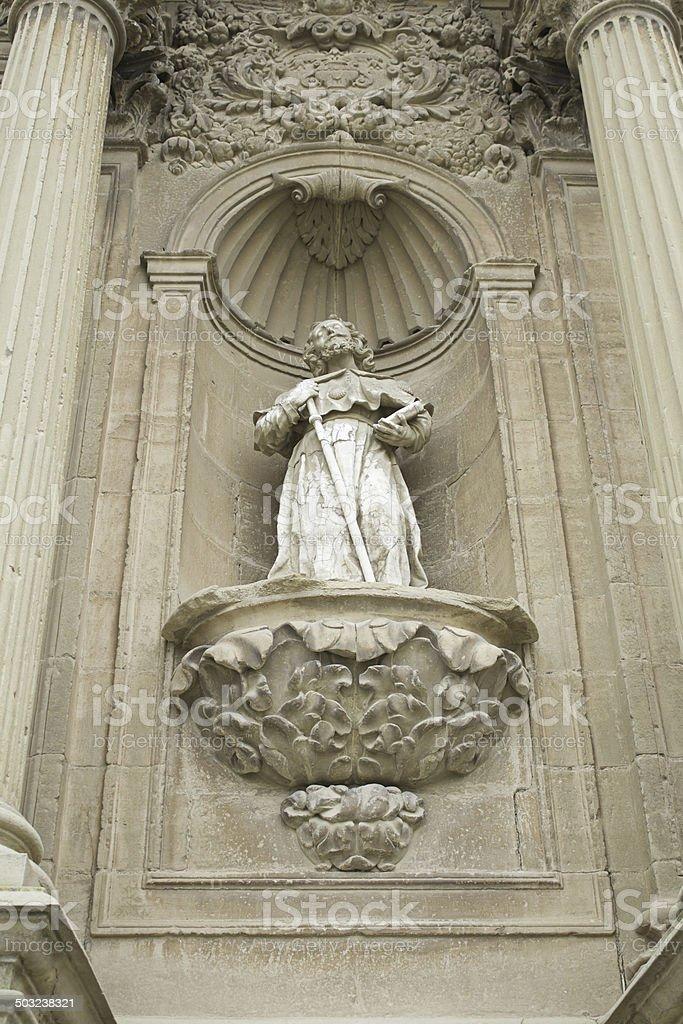 Saint on stone stock photo