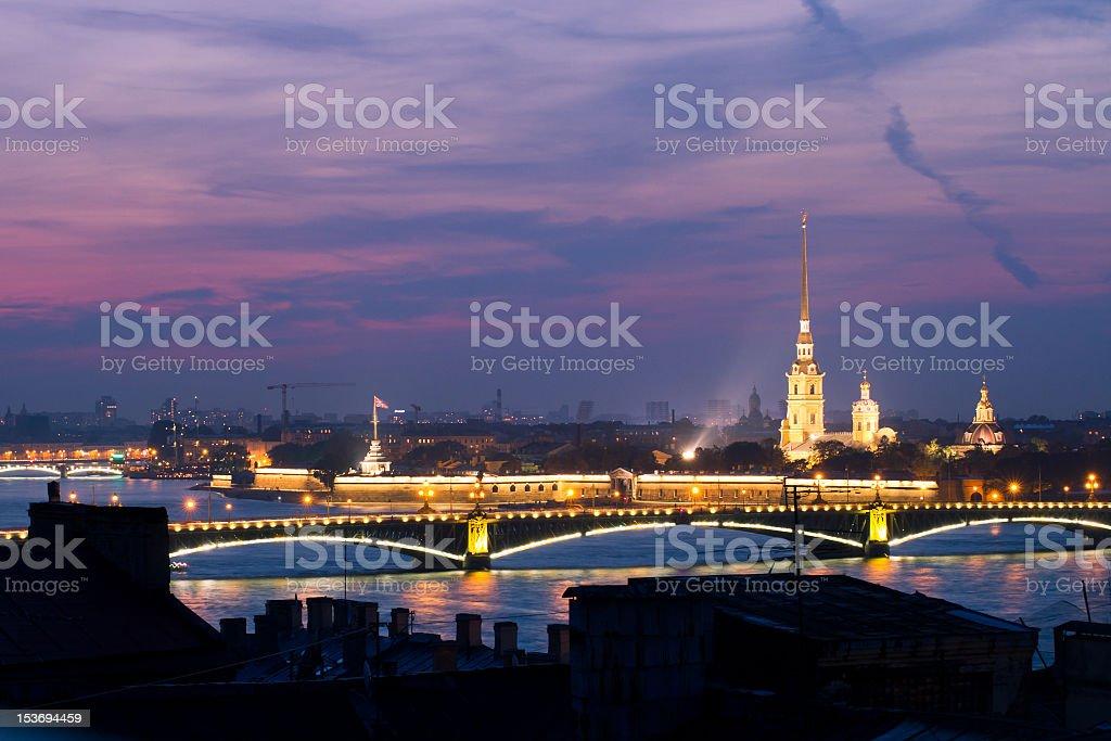 Saint Petersburg bridge and cathedral lit up at night stock photo