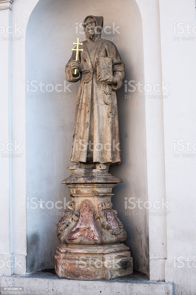 Saint statue on the wall of Church of St Joseph stock photo