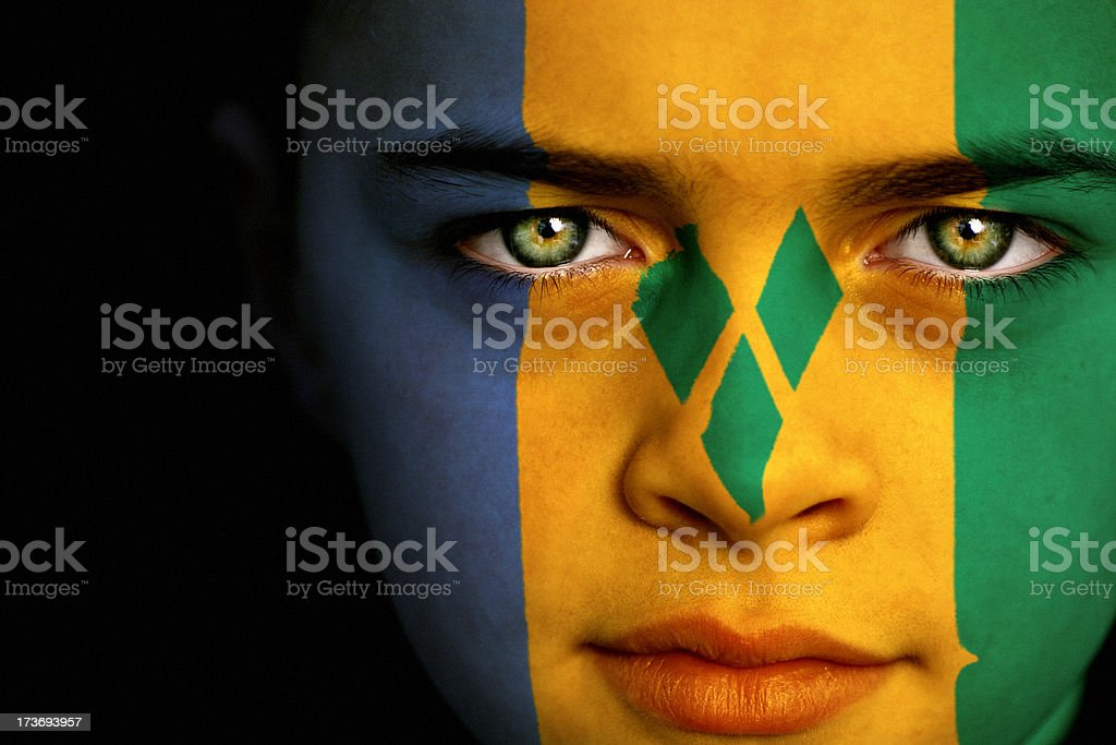 Saint Vincent and the Grenadines flag boy stock photo
