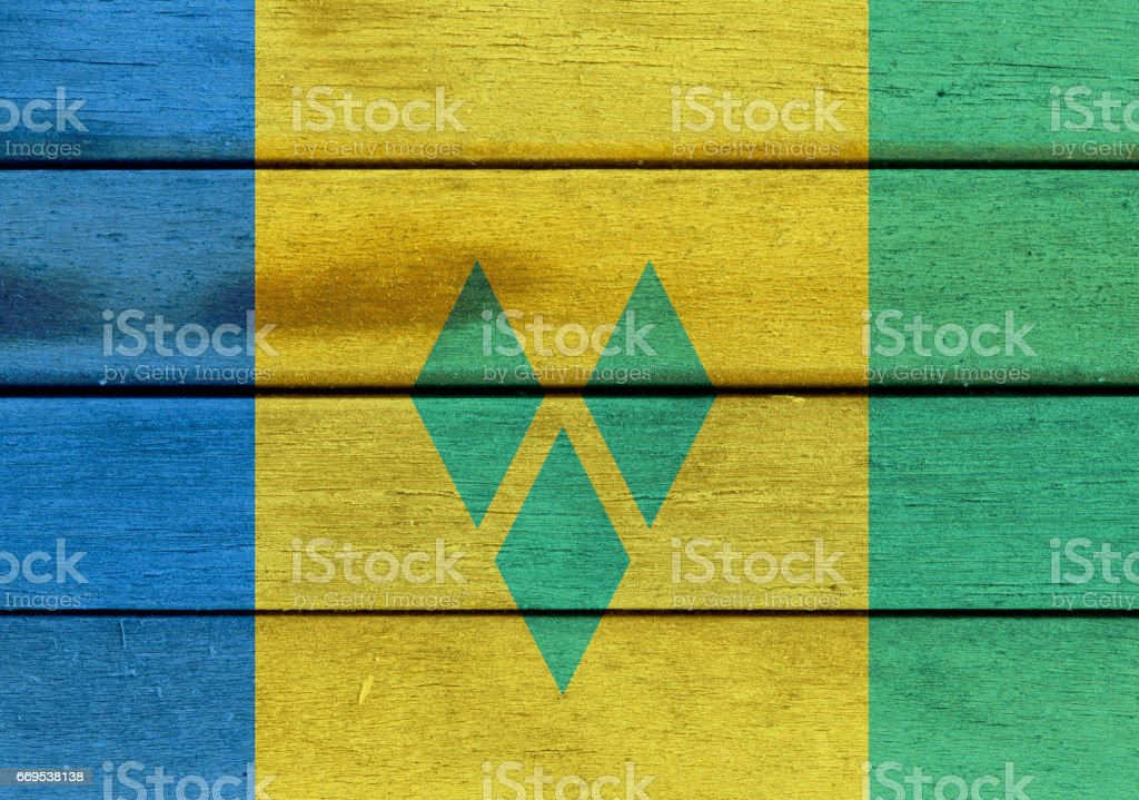 Saint Vincent and the Grenadines flag on a wood stock photo