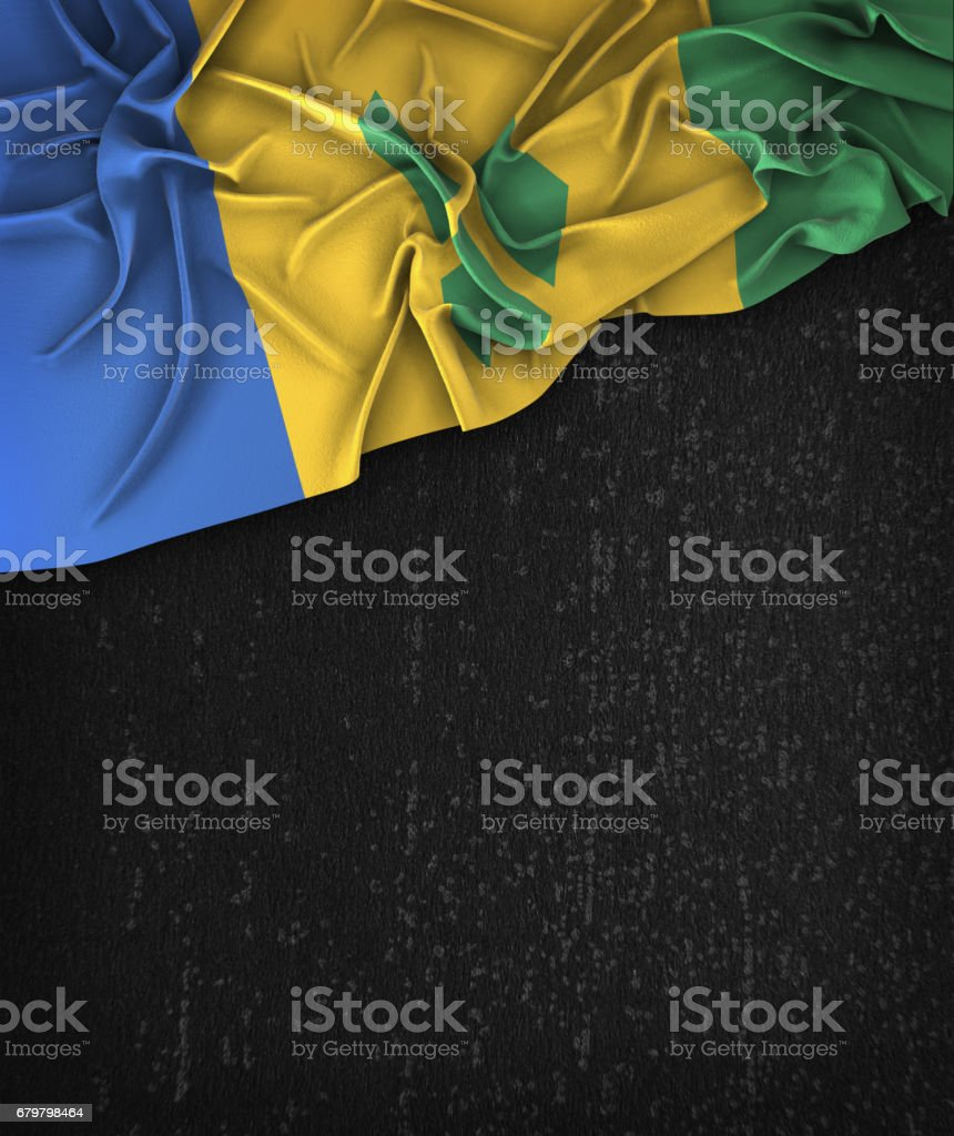 Saint Vincent and the Grenadines Flag Vintage on a Grunge Black Chalkboard With Space For Text stock photo