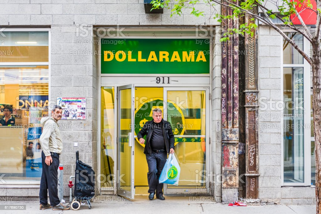 Sainte Catherine street in Montreal's Gay Village in Quebec region with Dollarama store and people walking stock photo