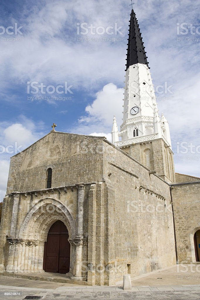 Saint-Etienne church with its black and white painted tower stock photo