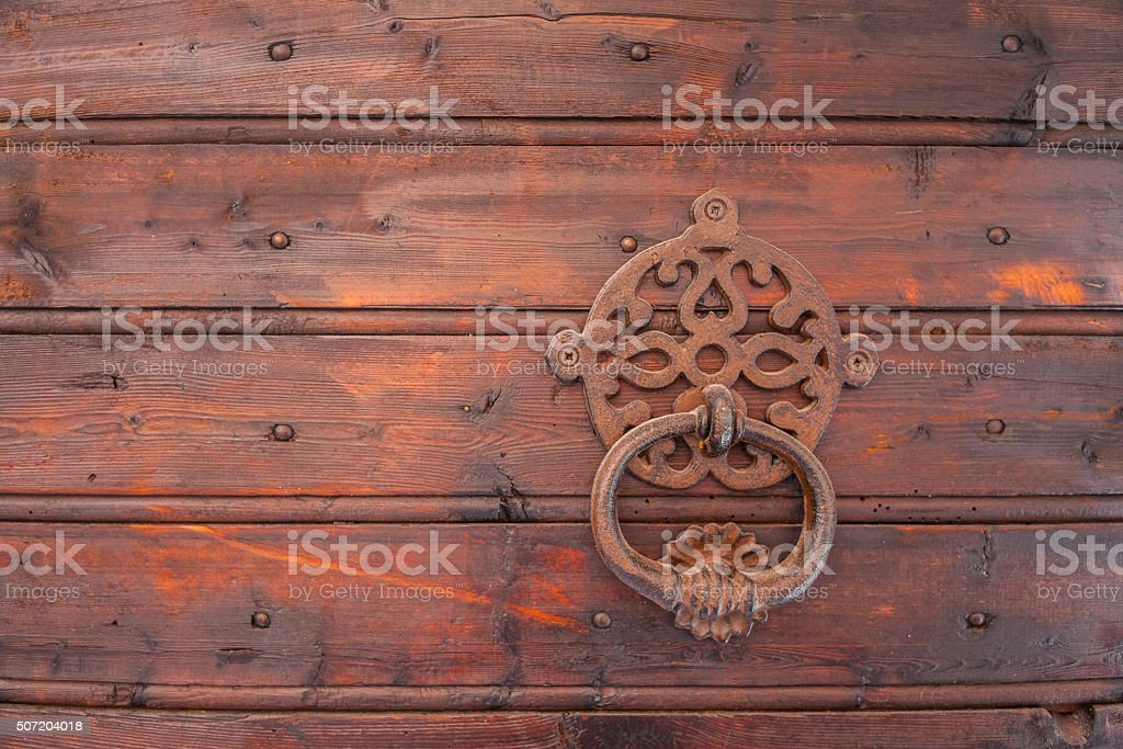 Saint-Jean-de-Maurienne (France). Medieval door-knocker in the old town stock photo