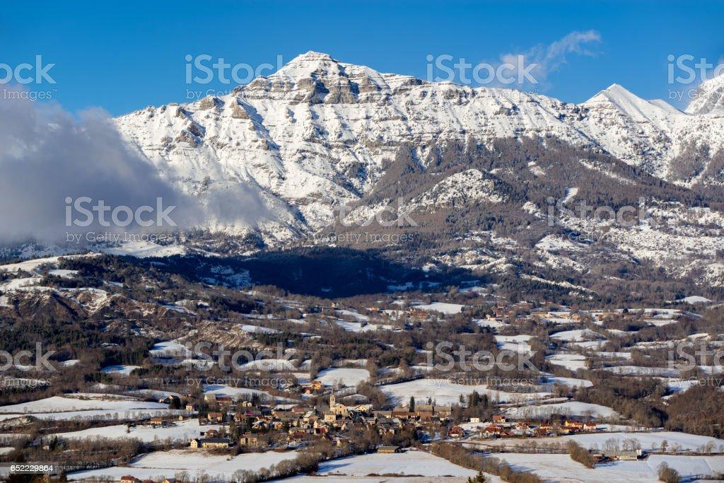 Saint-Julien-en-Champsaur and Queyrel Peak in winter. France stock photo